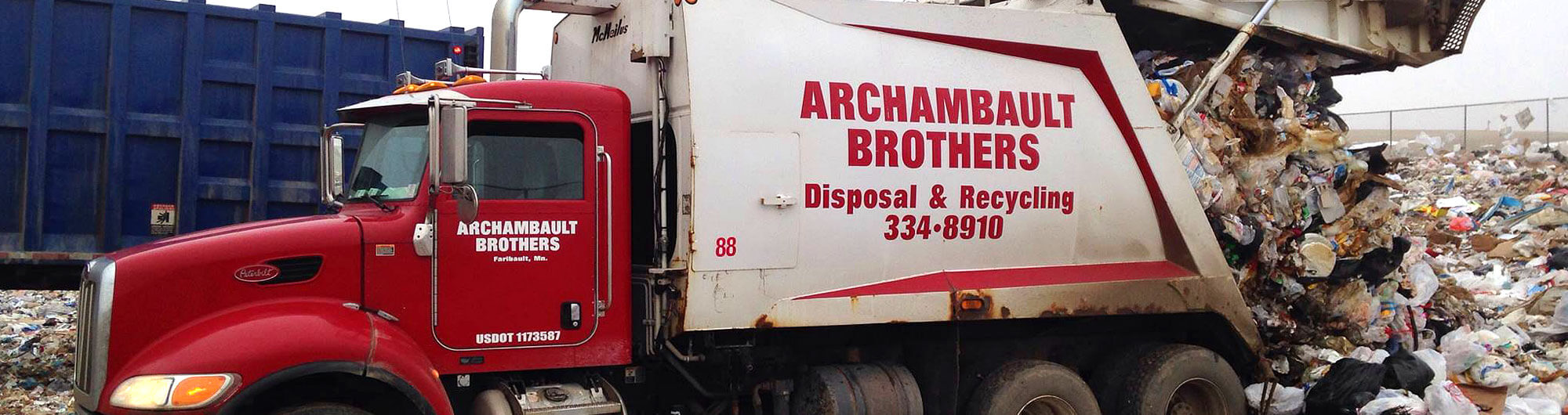 Archambault Brothers Disposal garbage truck dumping a load of trash